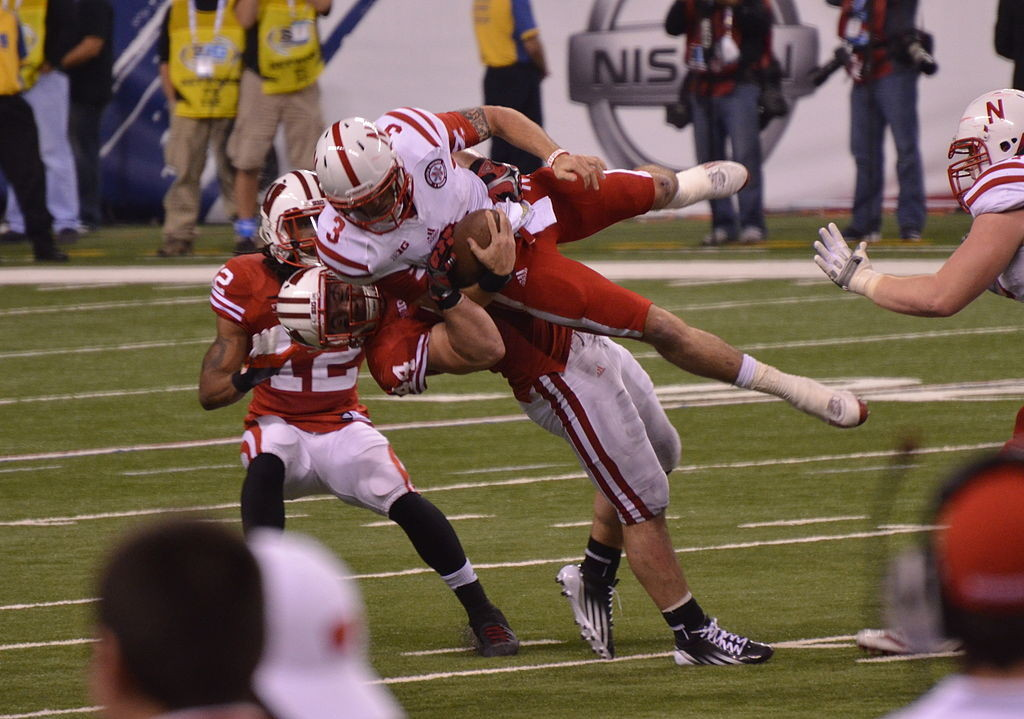 NFL retiree Chris Borland tackles Taylor Martinez.